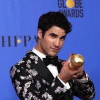 Darren Criss poses with his Golden Globe