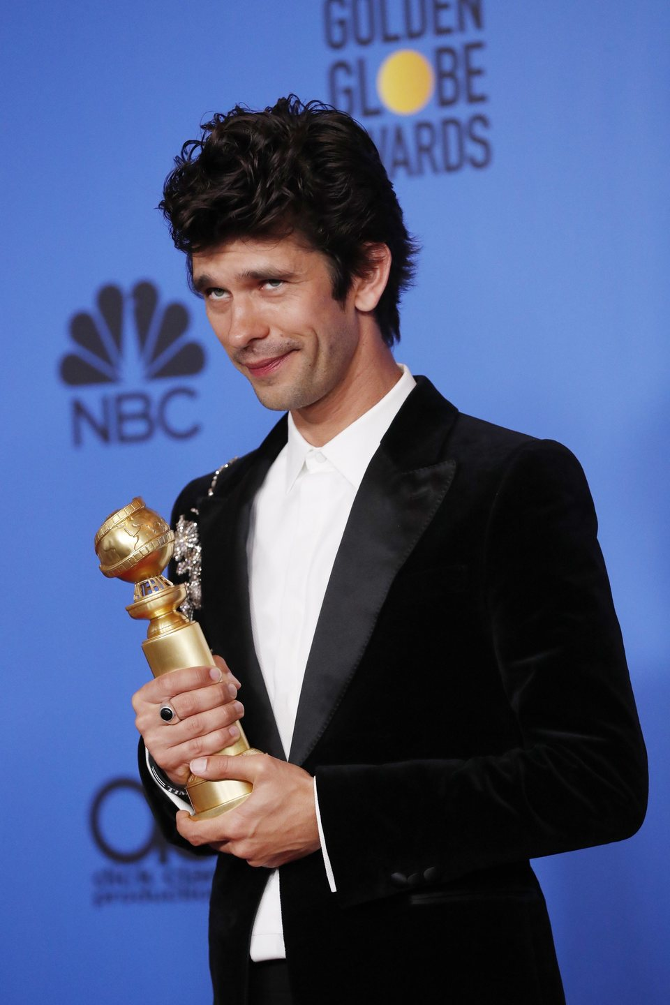 Ben Whishaw poses with his Golden Globe