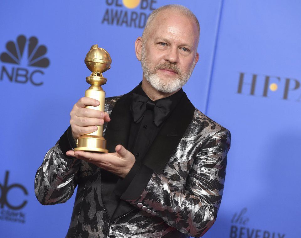 Ryan Murphy poses with a Golden Globe
