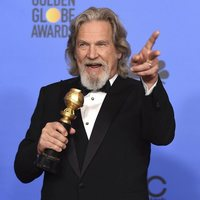 Jeff Bridges poses with his Cecil B. DeMille Award