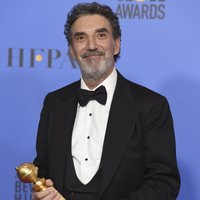 Chuck Lorre poses with the Golden Globe for Best Television Series, musical or comedy