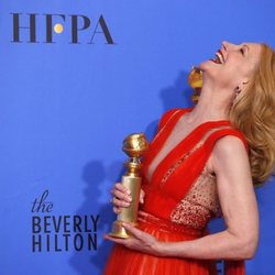 Patricia Clarkson poses with her Golden Globe