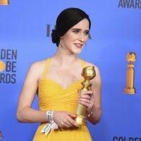 Rachel Brosnahan poses with her Golden Globe