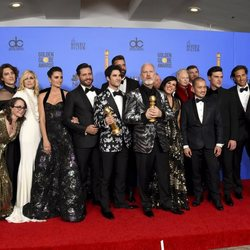 The cast of 'The Assassination of Gianni Versace: American Crime Story' with the two awards