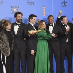 The crew of 'Spider-Man: Into the Spider-Verse' poses with their Golden Globe