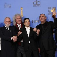 The cast of 'Bohemian Rhapsody' poses with its two Golnden Globes