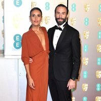 Joseph Fiennes and Maria Dolores Dieguez at the BAFTAs 2019 red carpet