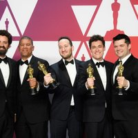 Oscar winners for Best Animated Feature Film for 'Spider-Man: Into the Spider-Verse' pose with their Oscars