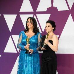 Oscar winners for Best Documentary Short Subject pose with their Oscars