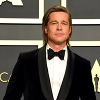 Brad Pitt with his Oscar to Best Performance by an Actor in a Supporting Role