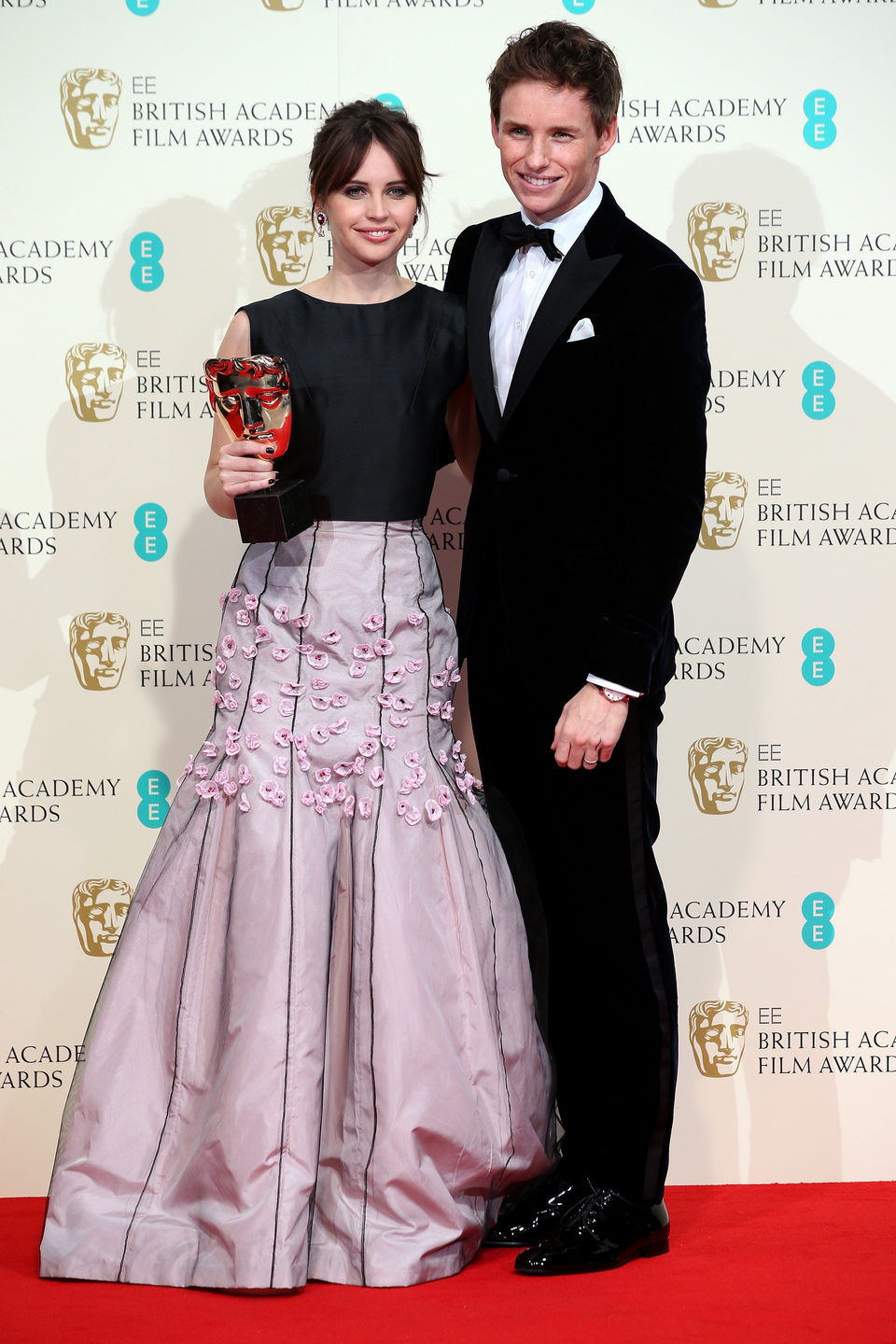 Felicity Jones and Eddie Redmayne poss with the Outstanding British Film Award for the 'Theory of Everything' at the BAFTA 2015
