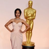 Zoe Saldana poses at the red carpet of the Oscar 2015