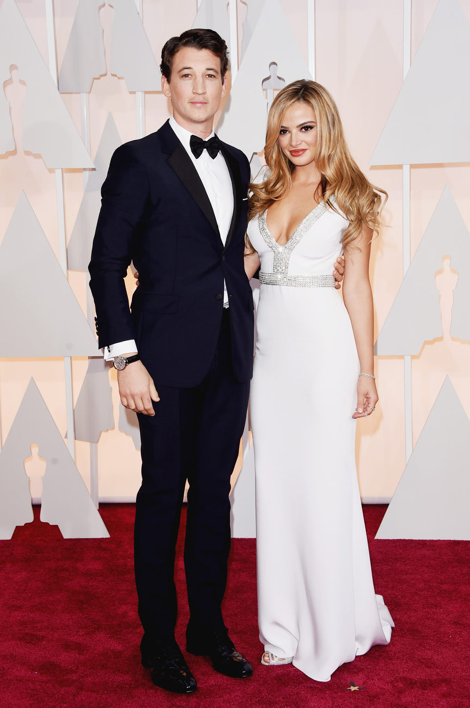 Miles Teller net to his girlfriend Keleigh Sperry at the Oscars Awards 2015 red carpet
