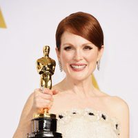 Julianne Moore poses with her Best Actress Oscar Award