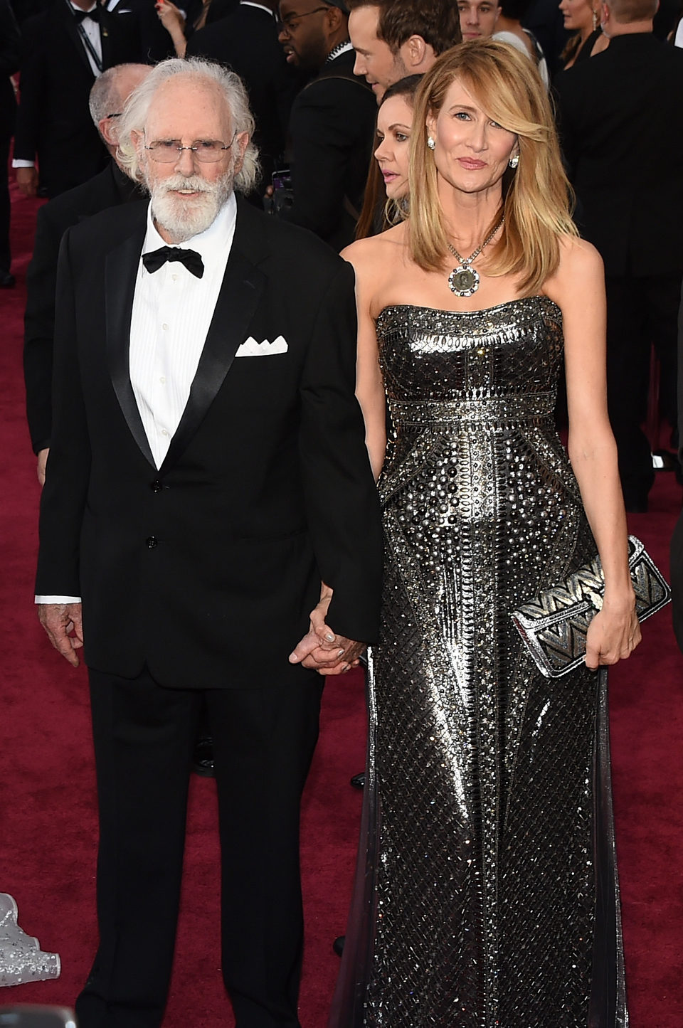 Bruce and Laura Dern poss in the Oscar 2015 red carpet