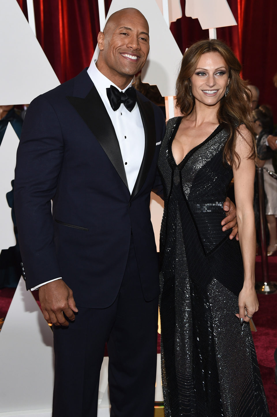 Dwayne Johnson and Lauren Hashian in the Oscar 2015 red carpet