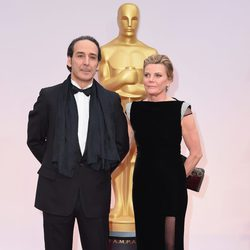 Alexandre Desplat and Dominique Lemonier in the Oscar 2015 red carpet