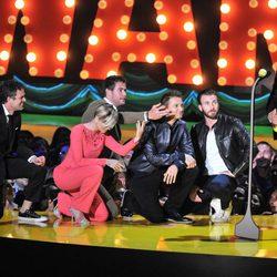 The Avengers kneel before Robert Downey Jr. at the MTV Movie Awards 2015