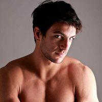 Shirtless Joaquín Ferreira looks shy to the camera