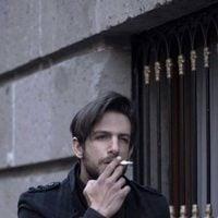 Joaquín Ferreira smoking on the street