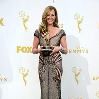 Allison Janney posing with her 2015 Emmy Award