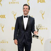 Jon Hamm posing with his 2015 Emmy Award