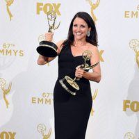 Julia Louis-Dreyfus posing with her two 2015 Emmy Awards