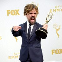 Peter Dinklage posing with his 2015 Emmy Award