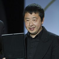 Director Jia Zhang-ke receives the Audience Award for his film 'Mountains May Depart' during the closing ceremony of the 63rd San Sebastian International F