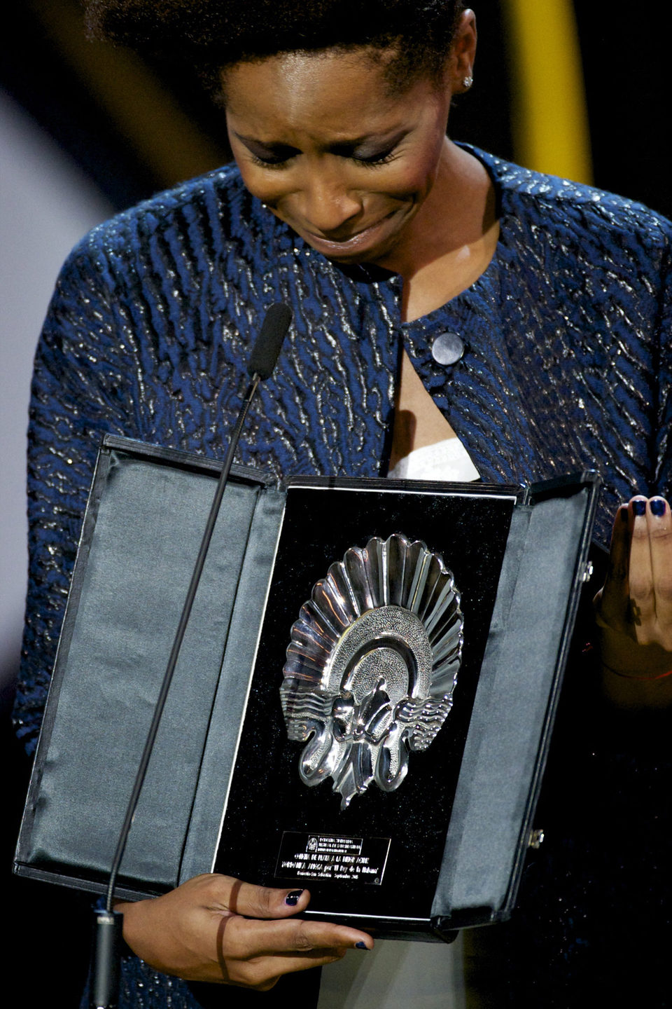 Yordanka Ariosa receives the Silver Shell for Best Actress for the film 'El rey de la Habana (The King of Havana)' during the closing ceremony red carpet o