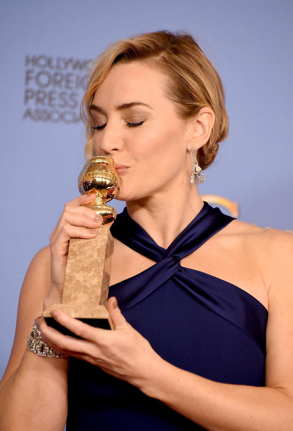 Kate Winslet with her Golden Globe Award for 'Steve Jobs'