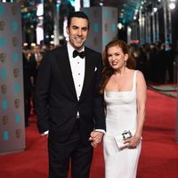 Sacha Baron Cohen and Isla Fisher at the 2016 BAFTA Awards' red carpet