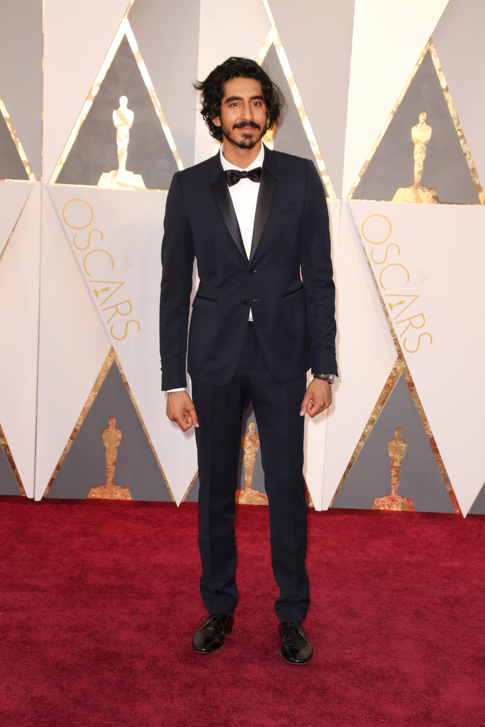 Dev Patel at the Oscars 2016 red carpet