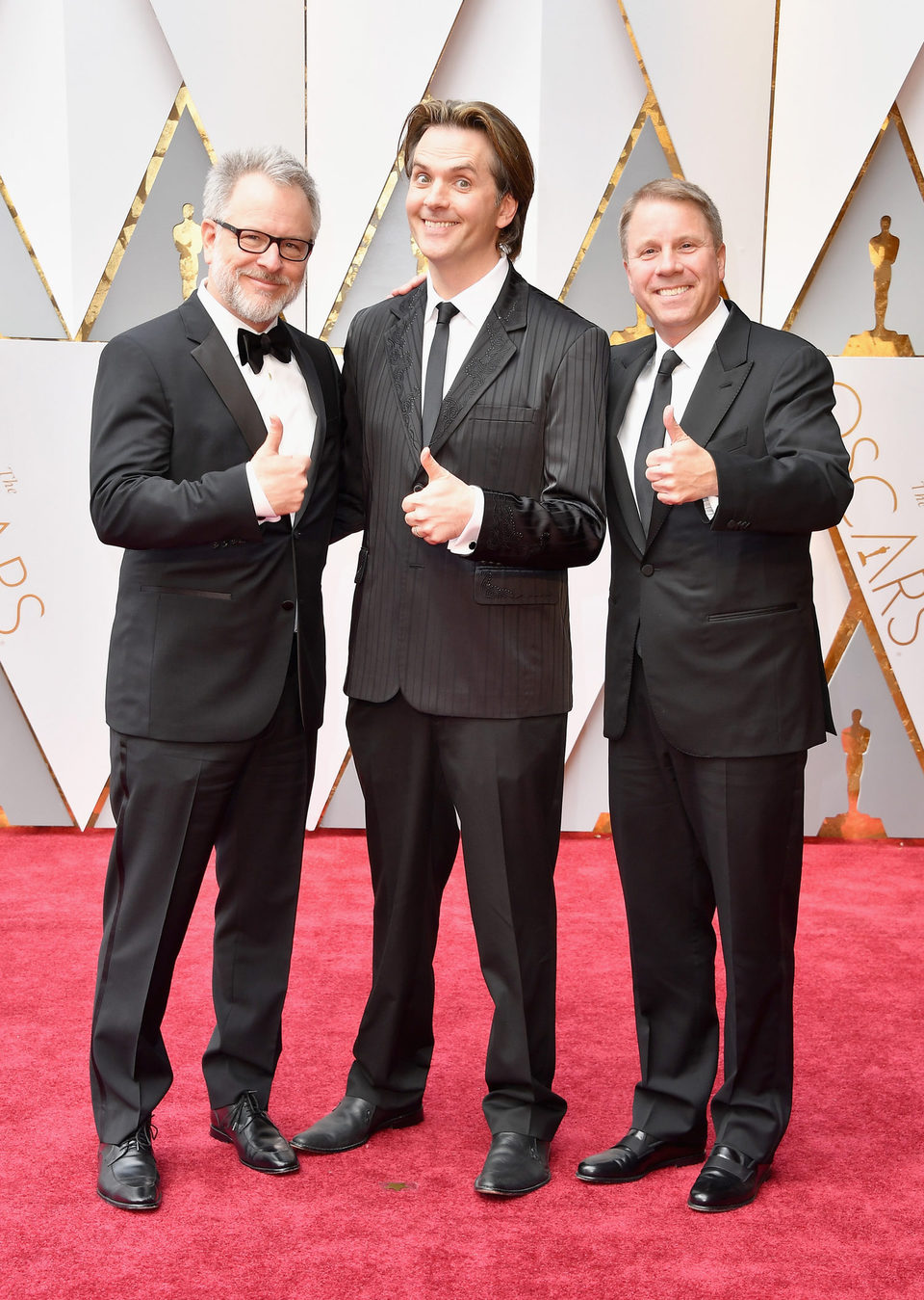 Rich Moore, Byron Howard and Jared Bush at the Oscars 2017 red carpet