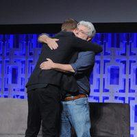 Hayden Christensen hugs George Lucas in the Star Wars Celebration