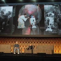 Warwick Davis and George Lucas in the Star Wars Celebration