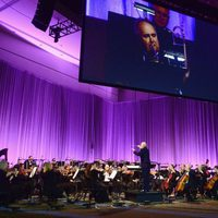 John Williams leading the orchestra in the Star Wars Celebration