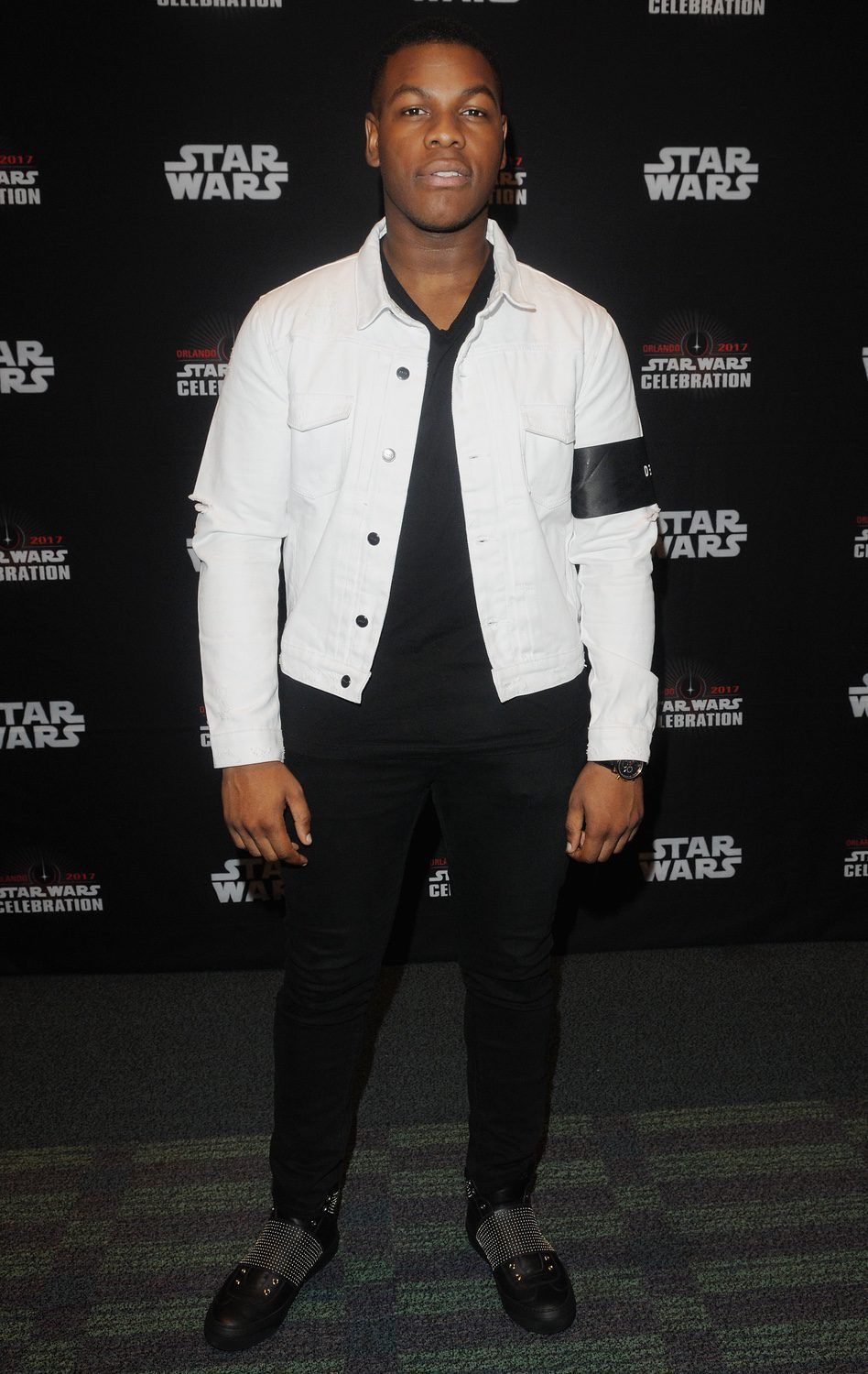John Boyega goes to Star Wars Celebration, and poses before the panel of 'The Last Jedi'
