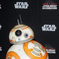 The robot BB-8 poses before the panel of 'The last Jedi' in the Star Wars Celebration
