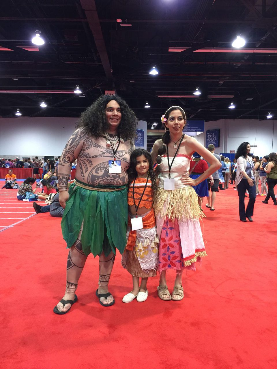 Family dressed up like characters of 'Moana' in the D23