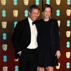 Hugh Grant and Anna Eberstein at the BAFTA Awards' 2018 red carpet