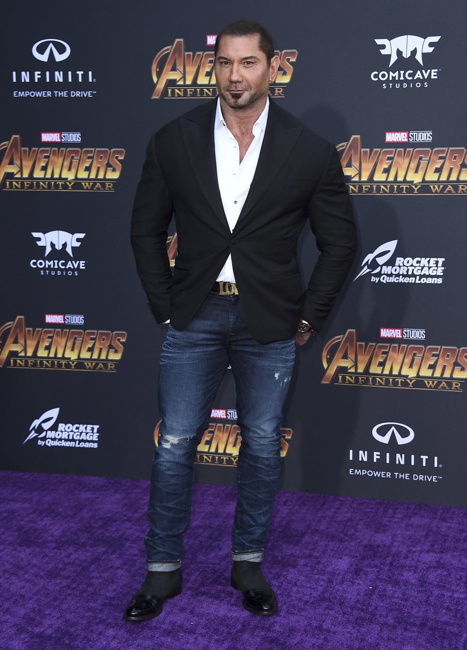 Dave Bautista poses on the purple carpet for the world premiere of 'Avengers: Infinity War'