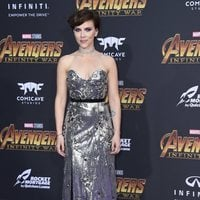 Scarlett Johansson poses on the purple carpet at the world premiere of 'Avengers: Infinity War'