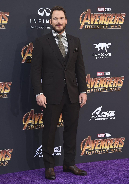 Chris Pratt poses on the purple carpet at the world premiere of 'Avengers: Infinity War'