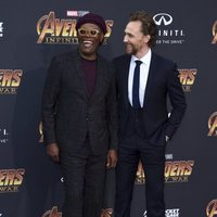 Samuel L. Jackson and Tom Hiddleston pose together on the purple carpet at the world premiere of 'Avengers: Infinity War'