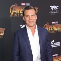 Josh Brolin poses on the purple carpet at the world premiere of 'Avengers: Infinity War'