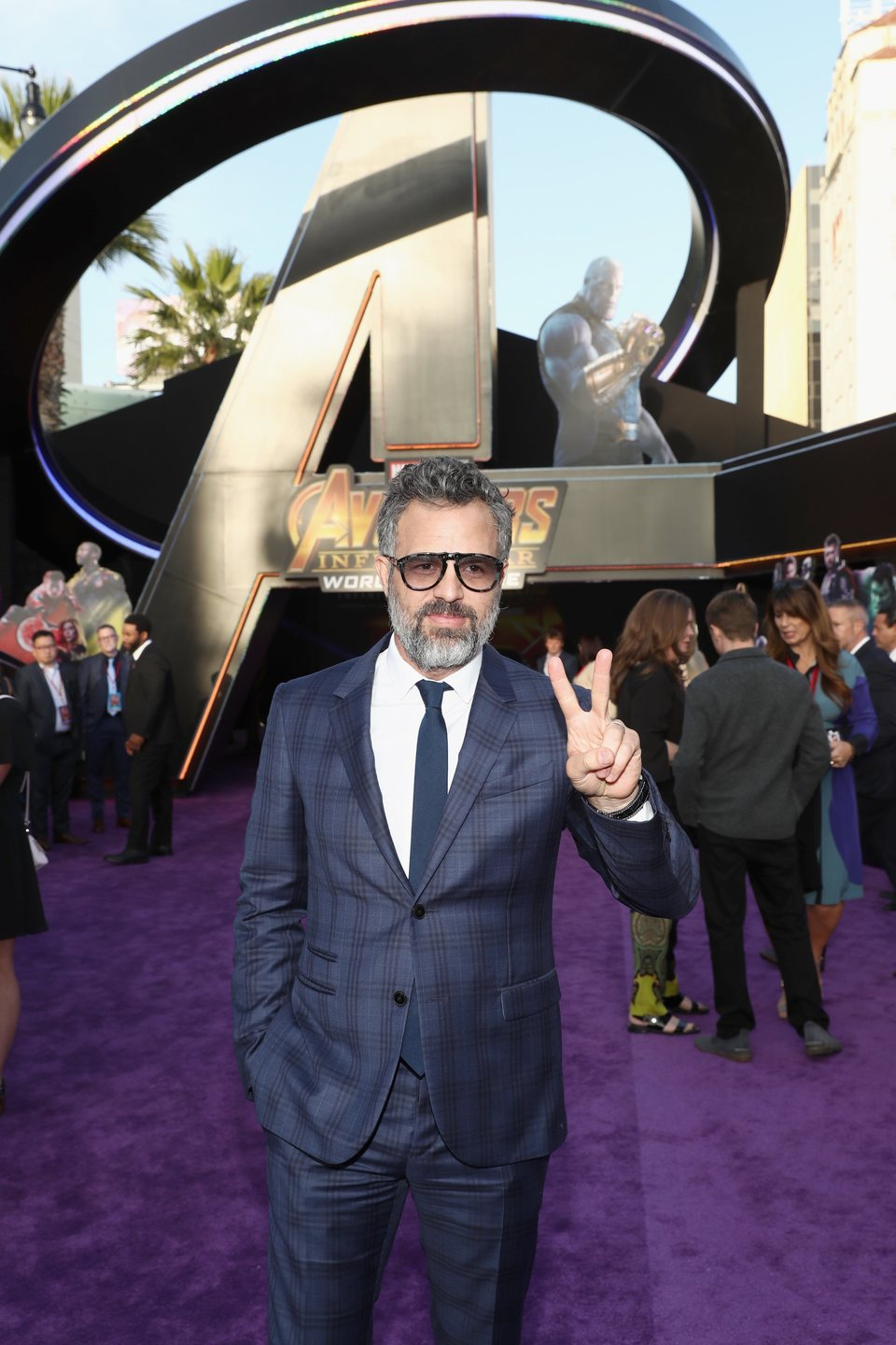 Mark Ruffalo poses on the purple carpet at the world premiere of 'Avengers: Infinity War'