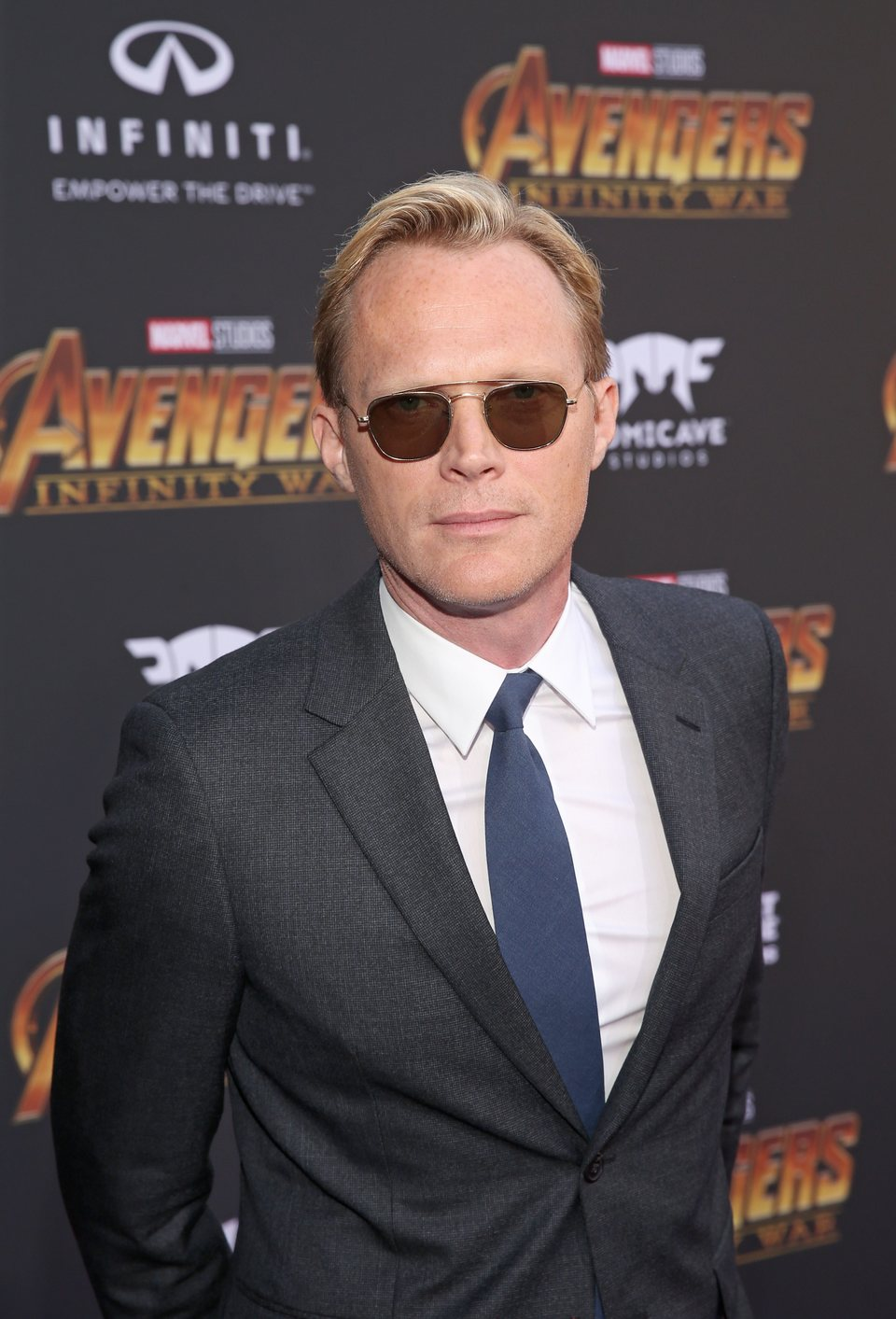 Paul Bettany poses on the purple carpet at the world premiere of 'Avengers: Infinity War'