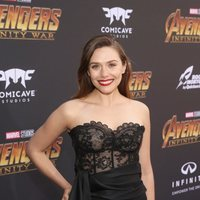 Elizabeth Olsen poses on the purple carpet at the world premiere of 'Avengers: Infinity War'