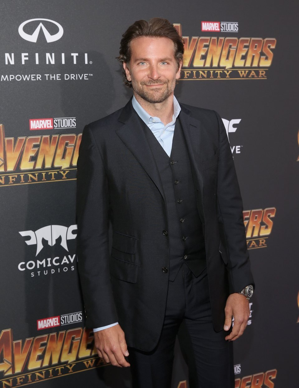 Bradley Cooper poses on the purple carpet at the world premiere for 'Avengers: Infinity War'